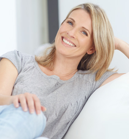 smiling woman relaxing in a chair